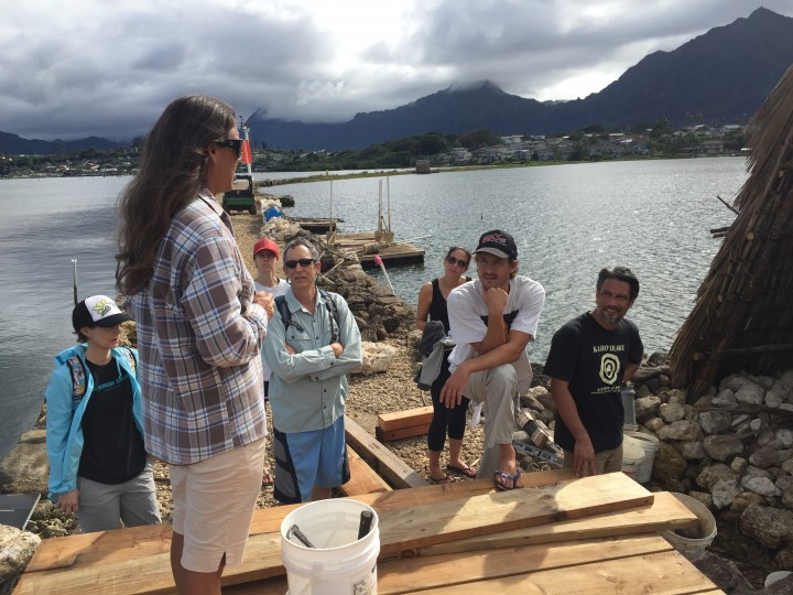 The PICCC team listens intently to the history of the fishpond
