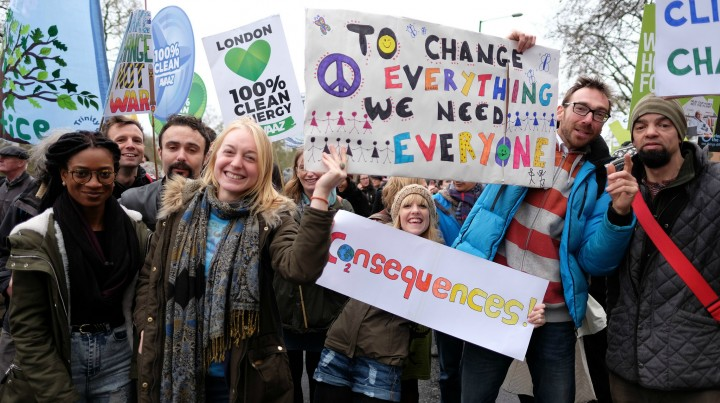Activists pose during a climate change rally prior to the IPCC Paris Meeting in 2015.
